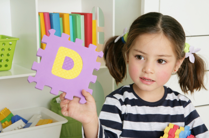 Preschool age girl playing ABC learning game